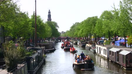 amsterodam : Cruising through Amsterdam channels at queensday in the Netherlands