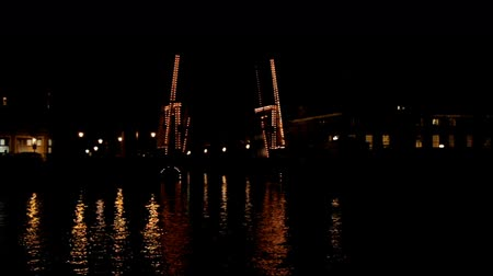 amsterodam : Thiny bridge in Amsterdam at night in the Netherlands