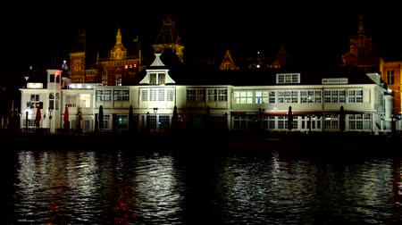 amsterodam : City scenic with the Central Station in Amsterdam the Netherlands at night