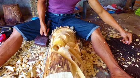Woodworker creating a piece of art in Bali Indonesia
