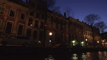 Medieval houses along the canal in Amsterdam Netherlands at sunset
