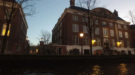 Medieval buildings along the canals in Amsterdam Netherlands at sunset