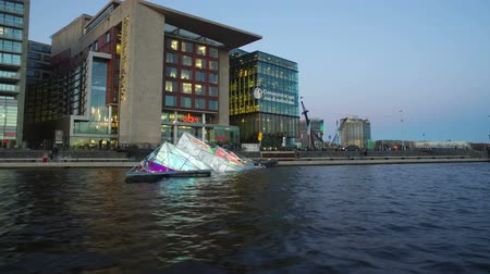 Floating Art at the Light Festival in Amsterdam Netherlands at sunset
