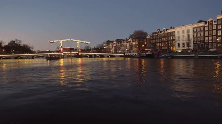Amsterdam at the Tiny bridge in the Netherlands at sunset