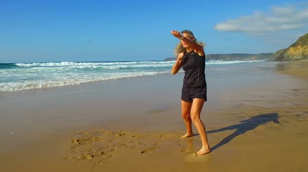Training for kickboxing on the beach