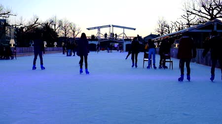 Ice skating at the ice rink at the Rijksmuseum in Amsterdam Netherlands