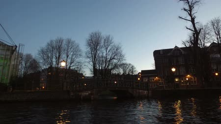 Cruising on the canals in Amsterdam Netherlands at sunset