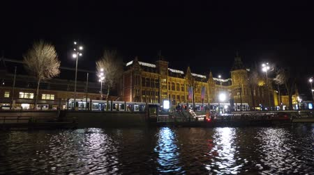 Amsterdam Central Station by night in the Netherlands Wideo