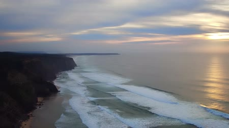 Aerial from beautiful sunset at Praia Vale Figueiras in Portugal