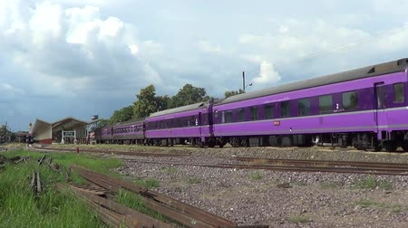locomotiva : CHIANGMAI , THAILAND - AUGUST 27 2014: HITACHI Diesel locomotive and train no.14 from chiangmai to bangkok. Footage at Chiangmai railway station.