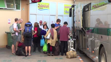 nan : CHIANGMAI, THAILAND -OCTOBER 19 2014 : Passengers of bus between Chiangmai and Golden triangle ( Chiangrai province ). Footage at New Chiangmai bus station, thailand. Stock Footage