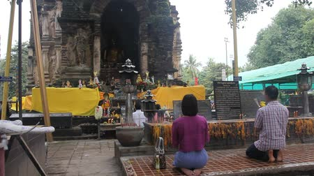 tapınaklar : People sacred Buddha image at Jed Yod temple, Old temple of chiangmai, thailand. Stok Video