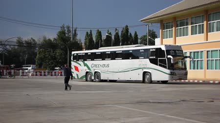 nan : CHIANGMAI, THAILAND -SEPTEMBER 30 2015: Scania Bus of Greenbus Company, Route Chiangmai and Phuket. Footage at New Chiangmai bus station, thailand.