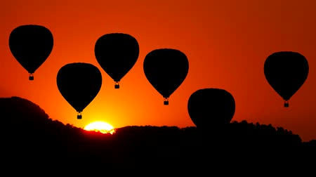from air : Animation of Hot Air Balloon move up with Mountain and Sun rise