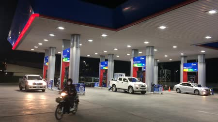 literário : CHIANGMAI , THAILAND - OCTOBER 23 2016: PTT Oil station. Location on road no.1101 about 5 km from chiangmai city. Chiangmai, Thailand.