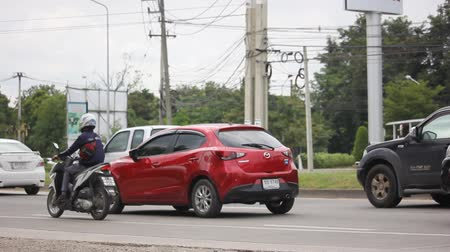 CHIANG MAI, THAILAND - OCTOBER 22 2017: Private Eco car Mazda 2. On road no.1001 8 km from Chiangmai Business Area.