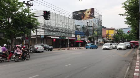 CHIANG MAI, THAILAND - APRIL 28 2018: Car and Traffic on Chiangmai City road . Clip at road in downtown of Chiangmai thailand.