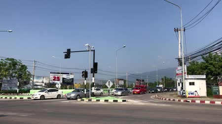 CHIANG MAI, THAILAND - MAY 16 2018: Traffic and Car on highway road in chiangmai city. Suthep Mountain background.