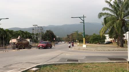Chiangmai, Thailand - December 20 2019: Road and Car in Chiang Mai University.  Founded in January 1964 and first provincial university in Thailand.