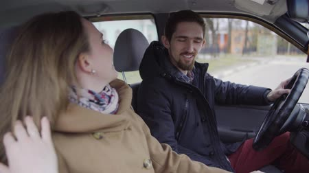 reconcile : Young couple reconciled in the car