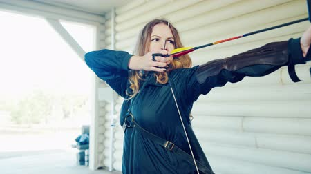 Girl shoots from a bow