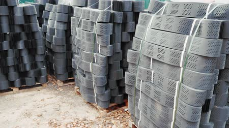 grating : Stacks of geogrid on pallets on the stock of the plant.