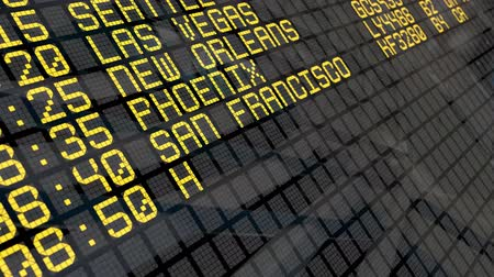bordo : CloseUp of an airport departure board with USA cities destinations.  4k video resolution 4096x2304. Stock Footage