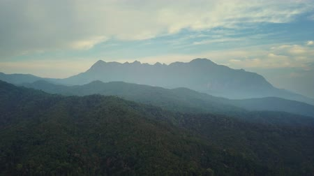 luang : Aerial View, Flying over the mountains and trees with beautiful clouds and sky in sunrise,Landscape nature with aerial camera shot,Doi Luang Chiang Dao-Chiangmai Thailand.