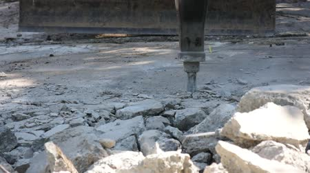reinforced concrete : Destruction of concrete floor by using machinery compression shock before new pouring concrete.