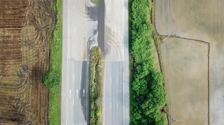 幾何学的配置庭園 : Aerial View, Flying over the highways and beautiful rice field with moving car in bird eye view ,Landscape road and green nature with aerial camera.