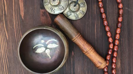 curar : Items for religious ritual: singing bowl, a drum beads, magic balls and percussion plate, top view Stock Footage