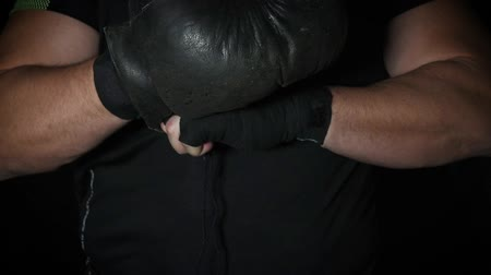 bandage : black leather boxing gloves