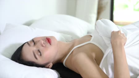 wakeup : Beautiful asian young woman sleeping lying in bed with head on pillow comfortable and happy moving panning camera. girl with relax for health concept, slow motion.