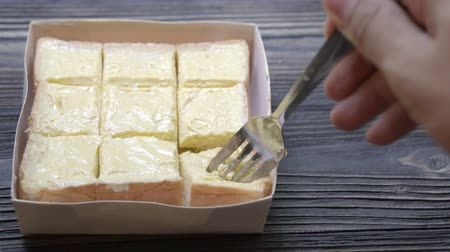 négyszögletes : bread spread butter on a slice on wood table, breakfast food with cheese cream tasty and delicious, moving motion. Stock mozgókép