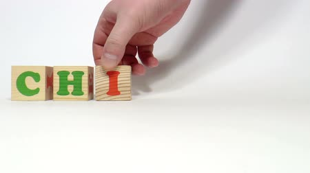 dialect : The video shows Chinese word built of wooden blocks Stock Footage