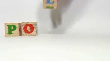 dialect : The video shows Polish word built of wooden blocks