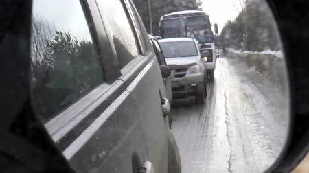 dirt : Turnpike. Nizhny Novgorod region - 2015_03_01. The video shows Winter road. Movement of cars in the rearview mirror Stock Footage