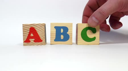blokkok : The video shows ABC word built of wooden blocks