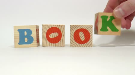 гимназия : The video shows book built of wooden blocks