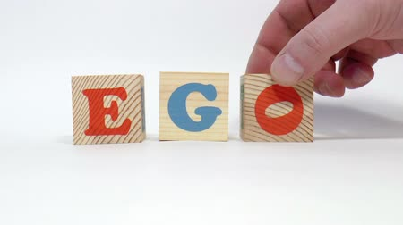 гимназия : The video shows ego word built of wooden blocks