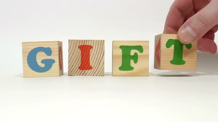 гимназия : The video shows gift word built of wooden blocks