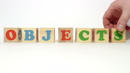 гимназия : The video shows objects word built of wooden blocks