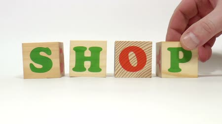 книжный магазин : The video shows shop word built of wooden blocks