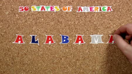 rajzszeg : Video shows word Alabama is one of the states of America on the cork Stock mozgókép