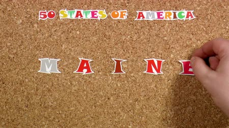 rajzszeg : Video shows word Maine is one of the states of America on the cork