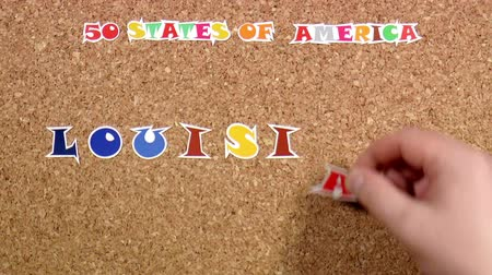 rajzszeg : Video shows word Louisiana is one of the states of America on the cork Stock mozgókép