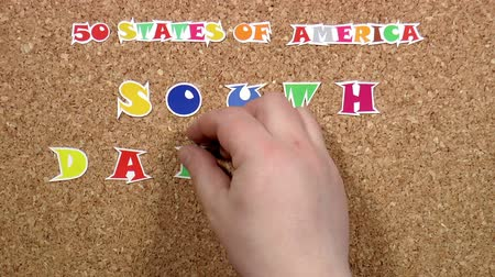 rajzszeg : Video shows word South Dakota is one of the states of America on the cork
