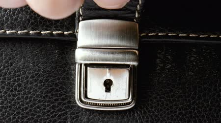 защелка : The video shows open metal buckle on textured leather Стоковые видеозаписи