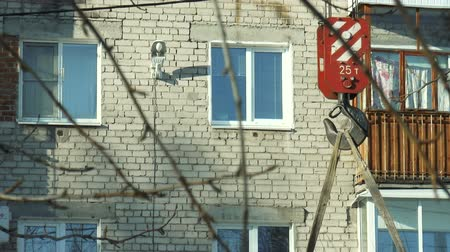 fasteners : DZERZHINSK, RUSSIA - MARCH 1, 2018: Builders fasten the boards to the crane hook. Construction works. Raising the boards with a crane