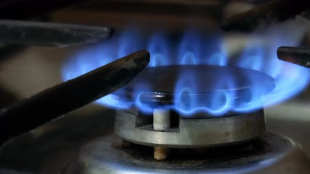 Video shows Gas burner with blue flame